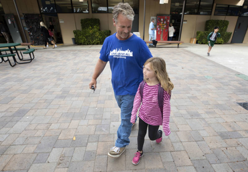 Bob Patterson picks up his daughter from school in Lomita on Oct. 30, 2017.