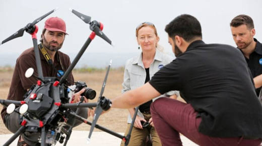 San Diego Zoo Global's science team (L-R): Dr. James Sheppard, Dr. Megan Owen, and Dr. Nicholas Pilfold work with the Northrop Grumman technical team in the field to refine their sensor suite to meet the needs of their Arctic conservation efforts.