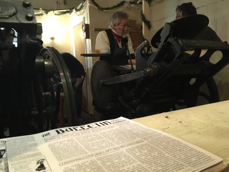A real printing press is used throughout the fair, one of many touches that makes the experience feel like stepping into another era.