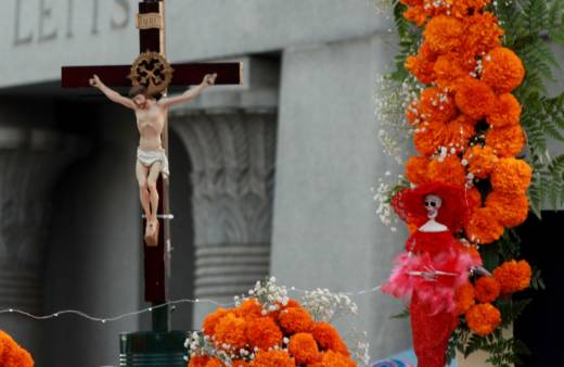Dia de Los Muertos typically blends sacred religious iconography with decidedly non-religious items and images to reflect the spiritual and the temporal life, as here during a celebration last month at Hollywood Forever Cemetery.
