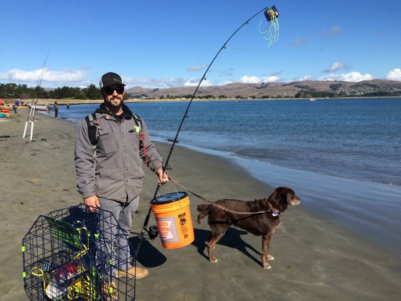 Garret Medeiros, of Novato, and his dog joined other eager fisherman for opening day.