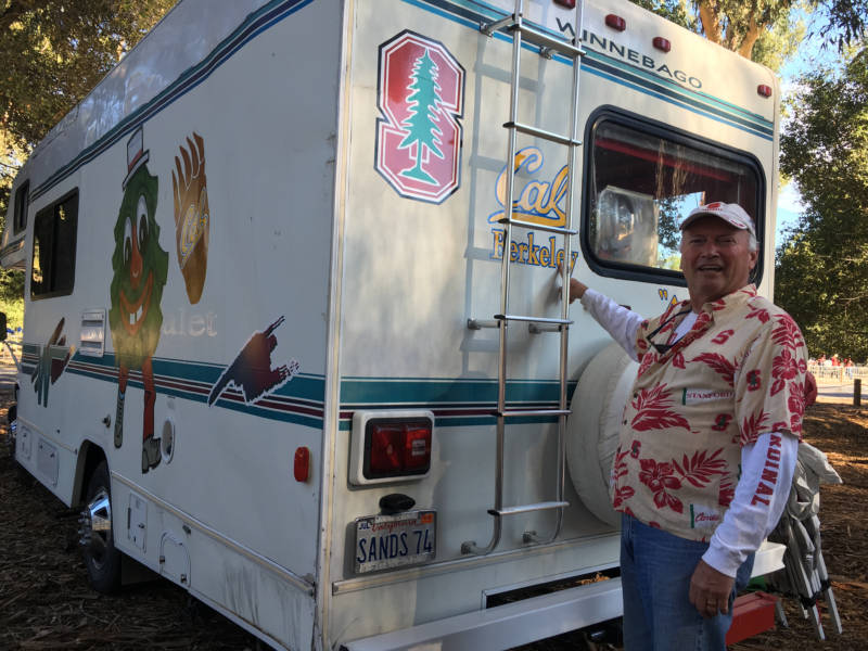 """Dean Sands, from Placerville, has been attending the Big Game for over 40 years. He got custom decorations for his camper to reflect his """"divided"""" home."""