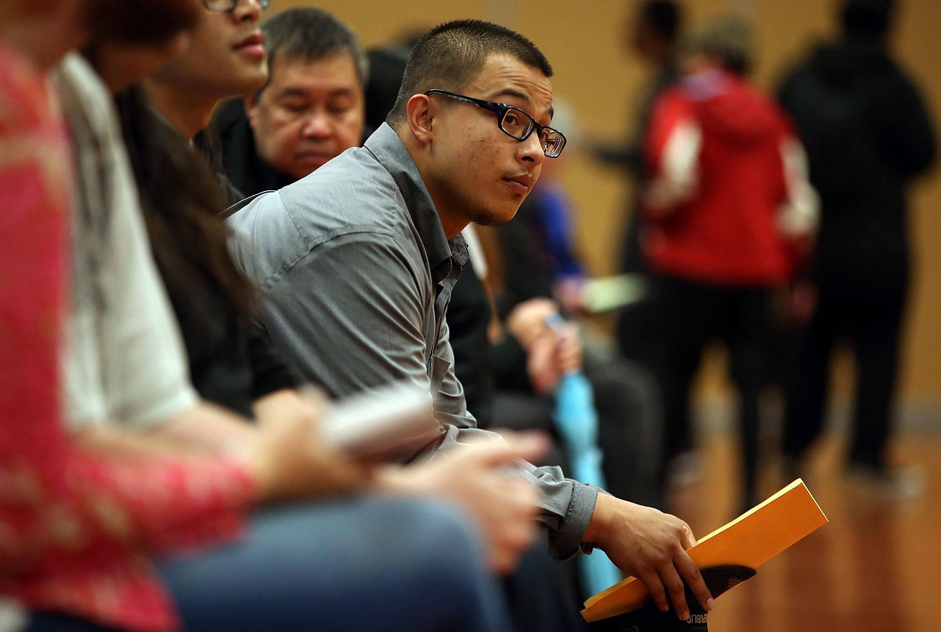 A job seeker waits to be interviewed during a job fair in Santa Clara. Justin Sullivan/Getty Images