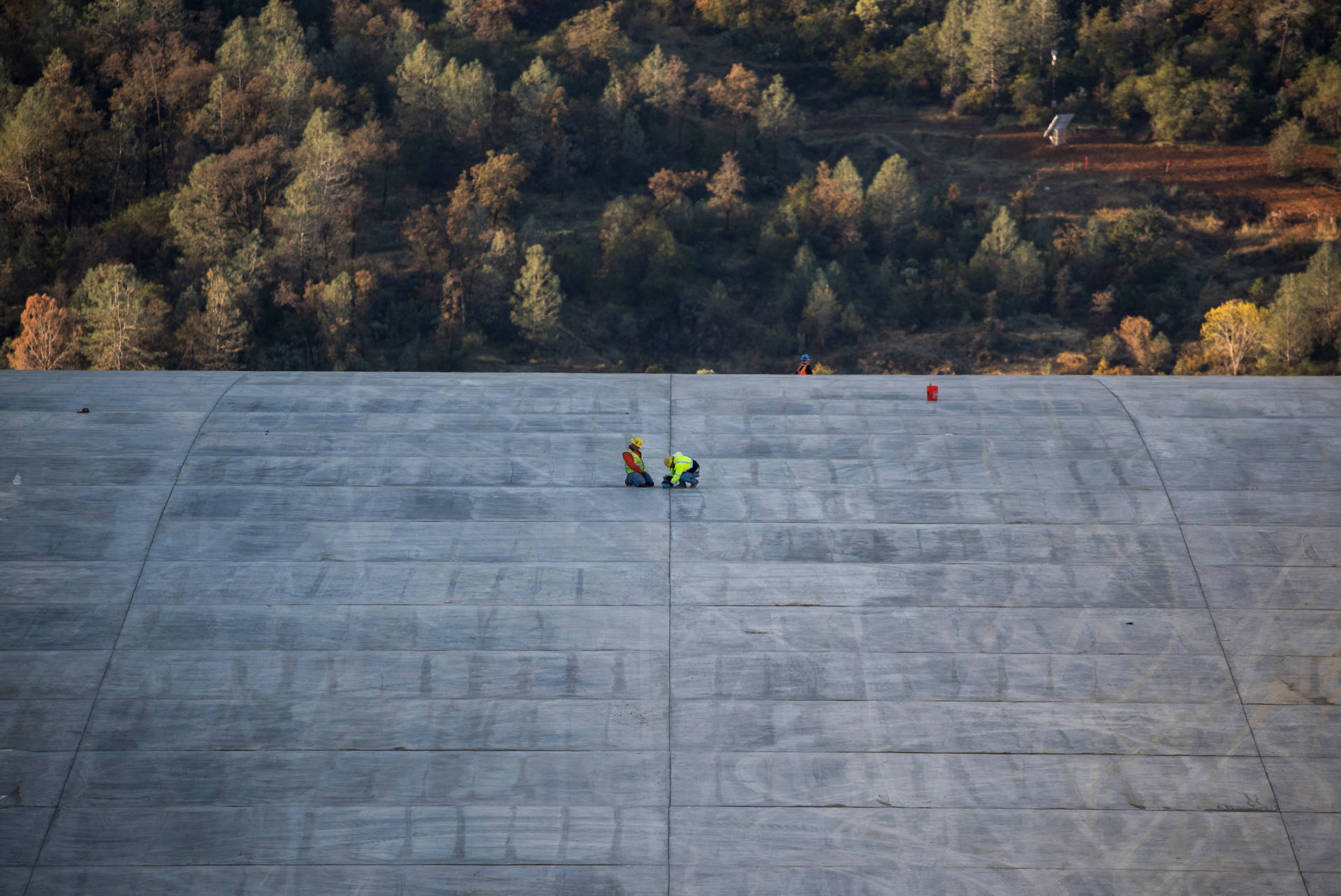 Workers last week continued finishing work on the upper chute of Oroville Dam's main spillway. Ken James/California Department of Water Resources
