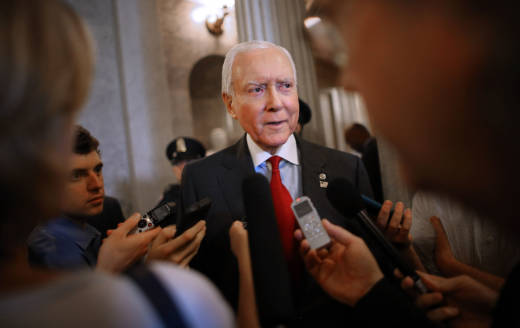 Senate Finance Committee Chairman Orrin Hatch, R-Utah, talks with reporters at the Capitol.