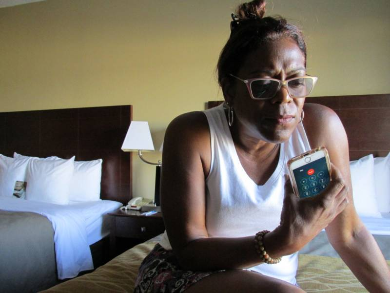 In her hotel room Hayden speaks to her son, William Mitchell, from the prison. About 1,200 California prisoners are housed in Mississippi.