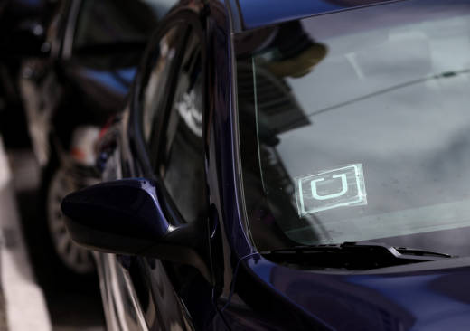 File Photo: A sticker with the Uber logo is displayed in the window of a car on June 12, 2014 in San Francisco, California.
