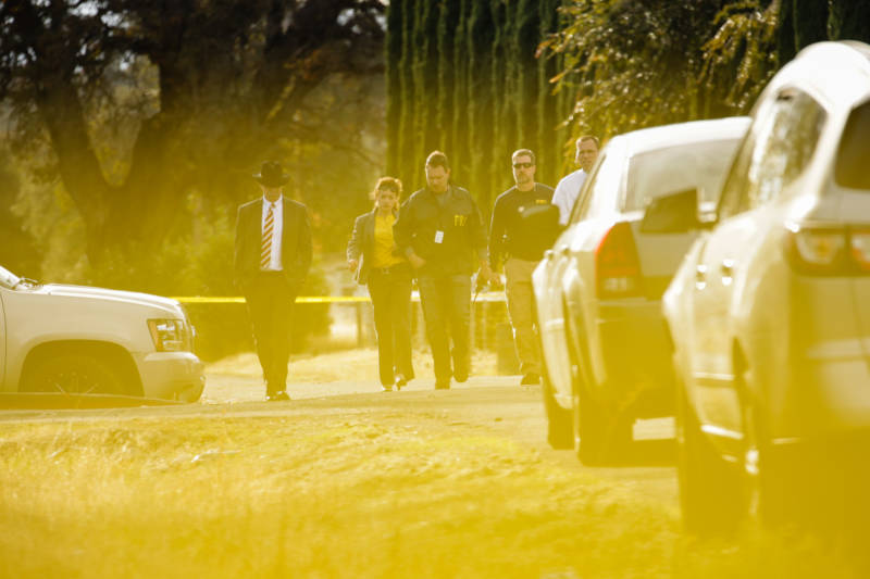 FBI agents are seen behind yellow crime scene tape outside Rancho Tehama Elementary School after a shooting in the morning on November 14, 2017, in Rancho Tehama.
