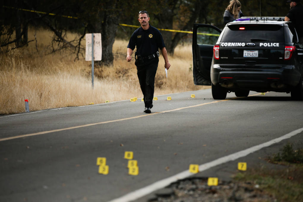 A law enforcement officer is seen at one of many crime scenes after a shooting on November 14, 2017, in Rancho Tehama, California.