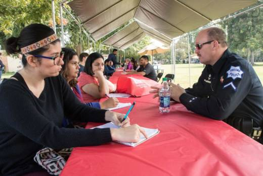 """Fresno police detective Sammy Ashworth, right, was one of the most popular books at Reedley College's """"human library"""" event."""