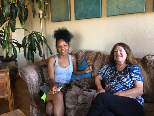 Nikkii Creer (left) and Teryl Burt (right) sit in Burt's living room two weeks into their stay together as part of the Safe Time program.