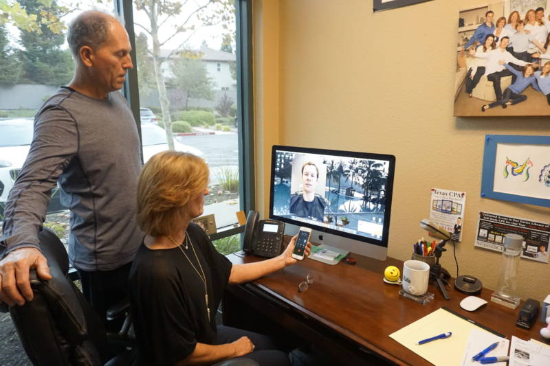 Kim and Russ Nash Skype with their sons Kyle and Austin, who run the San Diego office.