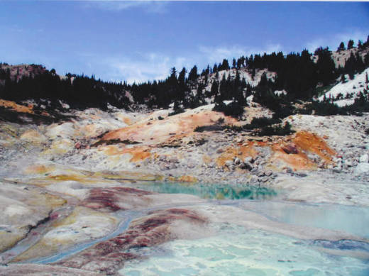 Colorful, hydrothermal soil surrounds the turquoise waters of West Pyrite Pool at Bumpass Hell.