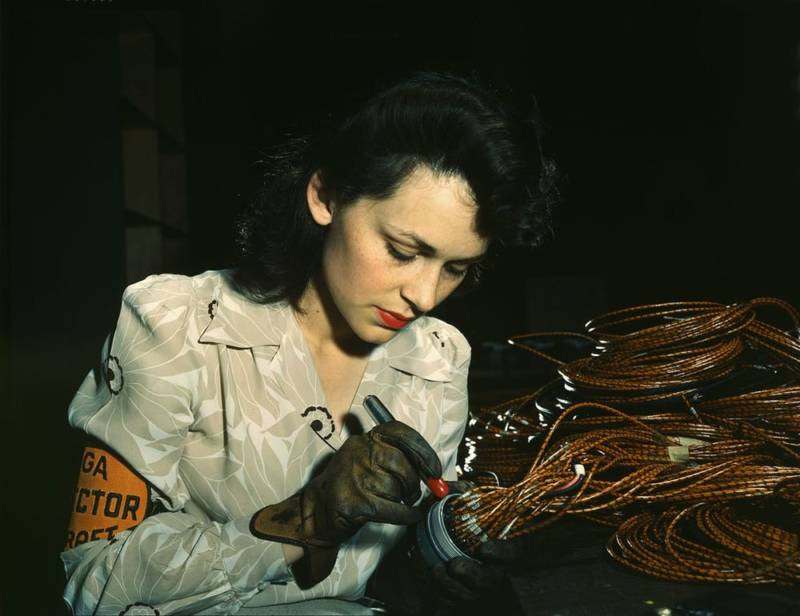 Worker at Vega Aircraft Corporation in Burbank checks electrical assemblies.