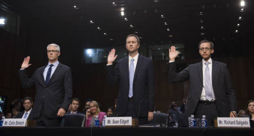 Colin Stretch (left), general counsel of Facebook; Sean Edgett (center), acting general counsel of Twitter; and Richard Salgado, director of law enforcement and information security of Google, are sworn in prior to testifying during a U.S. Senate Judiciary subcommittee hearing on Russian influence on social networks on Capitol Hill on Tuesday.