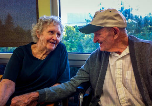 Gloria Single and her husband Bill Single in the dining hall of the skilled nursing floor at Pioneer House nursing home in Sacramento. AARP Foundation attorneys say California needs to more tightly enforce laws that prohibit evictions of the sort that separated the Singles, and sped up her physical decline.