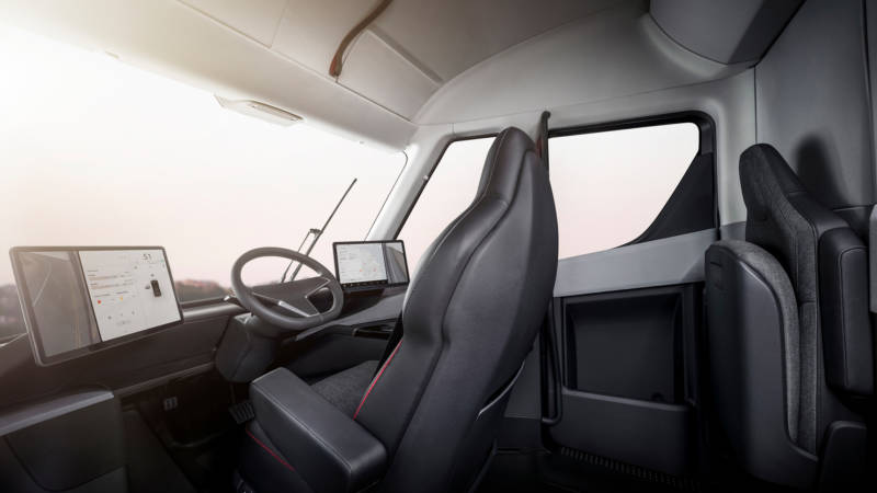 The driver's seat of the Tesla Semi is positioned in the center of the cab — which also provides standing room, the company says.