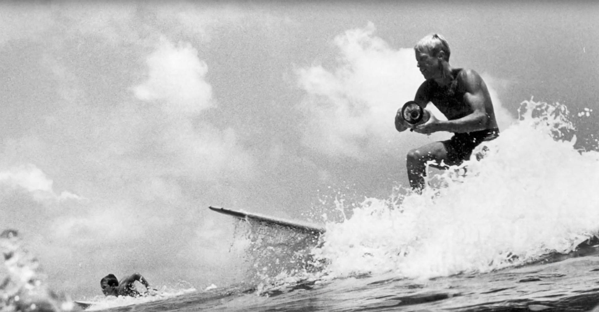 Bruce Brown, surfing with a camera. Red Bull/YouTube