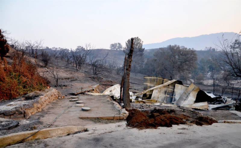 Many of the houses that burned in Ventura County, like this one off Highway 150 in the Upper Ojai Valley, complied with the county's strict brush clearing policies. December 13, 2017.