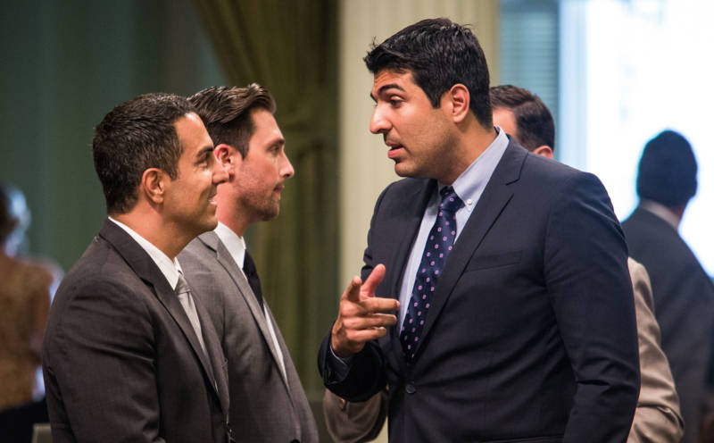 Assemblyman Matt Dababneh (D-Woodland Hills) (AT RIGHT) talks with colleagues in 2015.