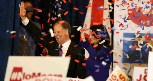 Democratic U.S. Senator elect Doug Jones (L) and wife, Louise Jones (R), greet supporters during his election night gathering at the Sheraton Hotel on Dec. 12, 2017, in Birmingham, Alabama.