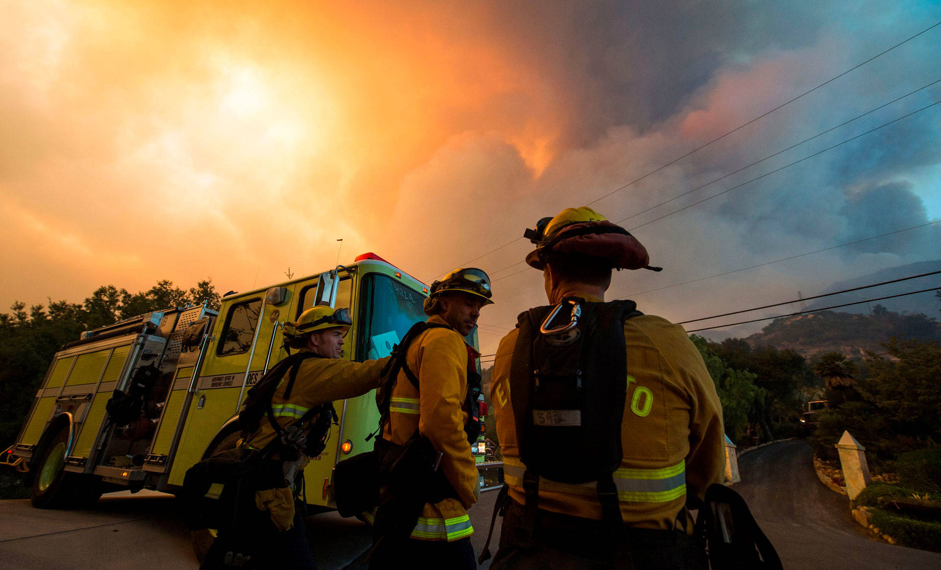 Firefighters monitor the advance of smoke and flames from the Thomas Fire on Dec. 16, 2017, in Montecito. ROBYN BECK/AFP/Getty Images