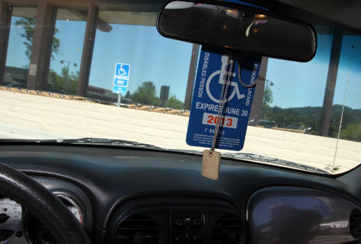 The disabled parking placards allow handicapped motorists to park for free and in designated parking spots.