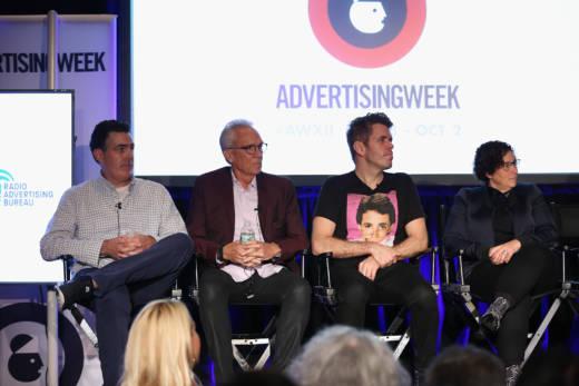 (L-R) Adam Carolla, Norman Pattiz, Perez Hilton, and Gayle Troberman speak onstage at The Golden Art of Podcasting panel on September 28, 2015 in New York City.