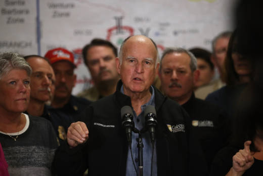 Gov. Jerry Brown gives a briefing on the Thomas Fire and other Southern California wildfires during a news conference at the Ventura County Fairgrounds on December 9, 2017 in Ventura, California.
