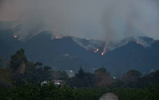 Fires burn across Romero Canyon hillside in Montecito, north of Santa Barbara on Dec. 12, 2017. Crews battling wildfires ravaging southern California for a week have managed to slow the spread of the worst of the blazes, officials said, as residents were taking stock of the catastrophic damage. The biggest, the Thomas Fire, has charred nearly 242,500 acres.