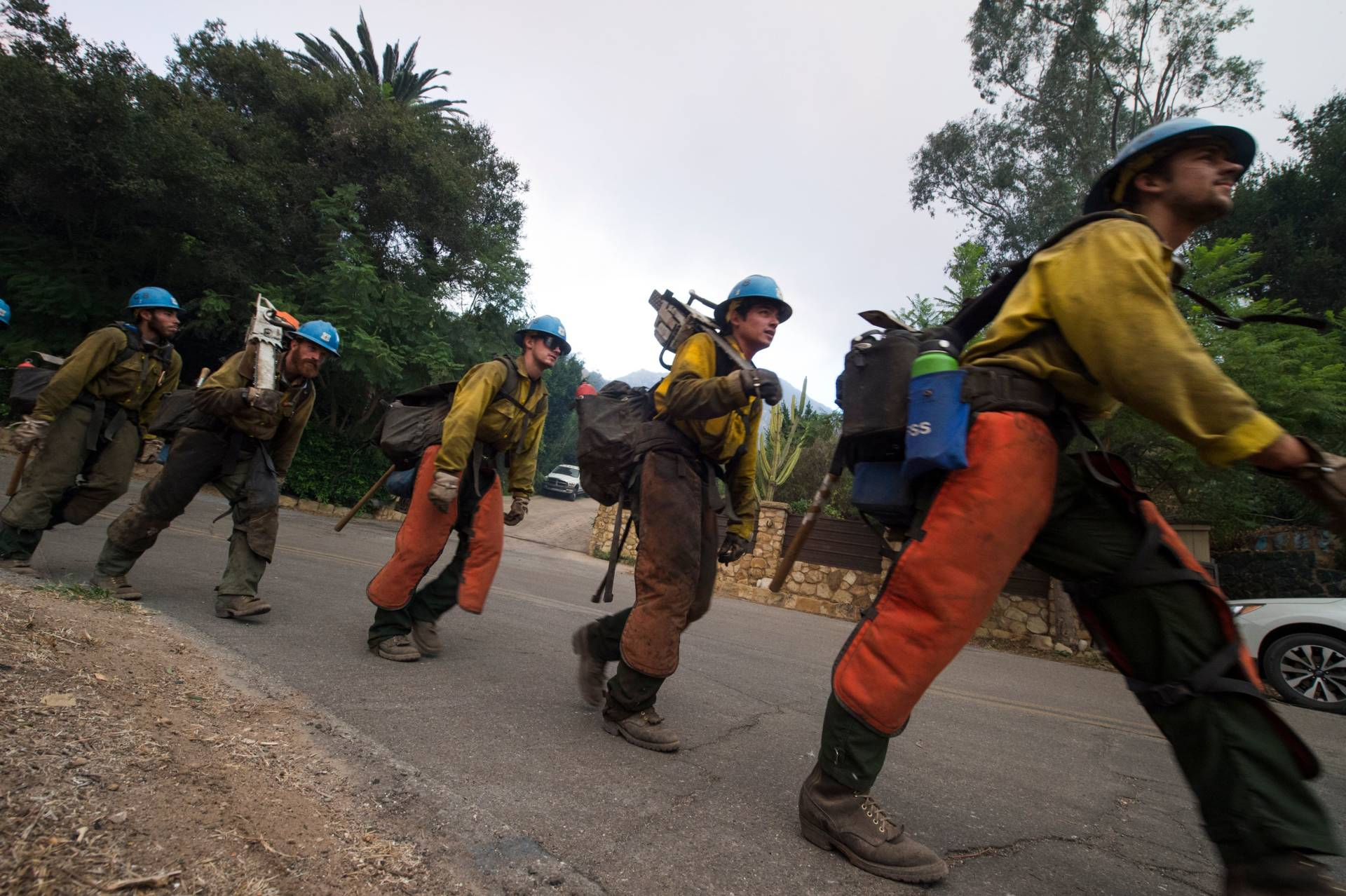 A firefighting hand crew moves into position to put out hotspots in Montecito, California, at the Thomas Fire on Dec. 16, 2017. Robyn Beck/AFP/Getty Images