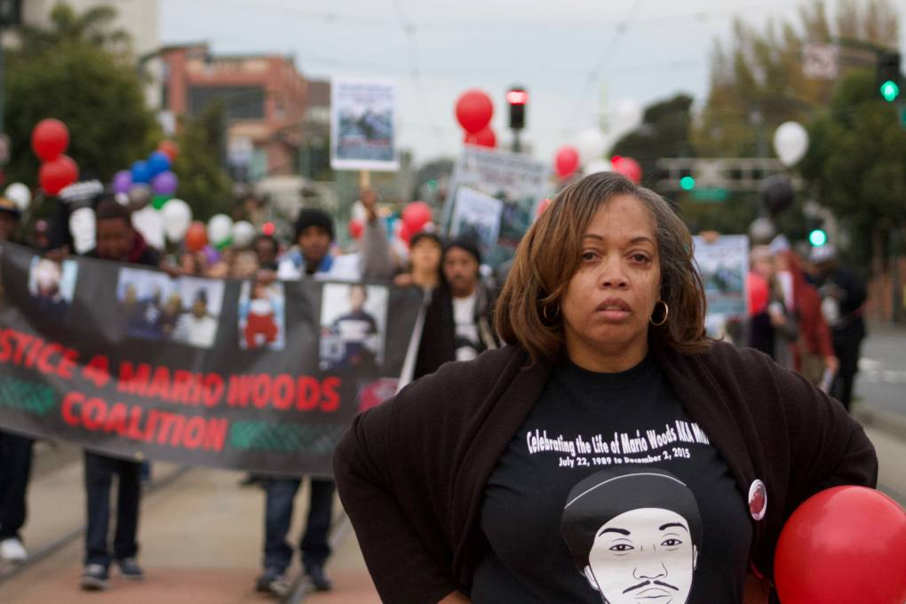 Gwen Woods leads a crowd on Dec. 2, 2017, to the site of her son's death in San Francisco exactly two years earlier.