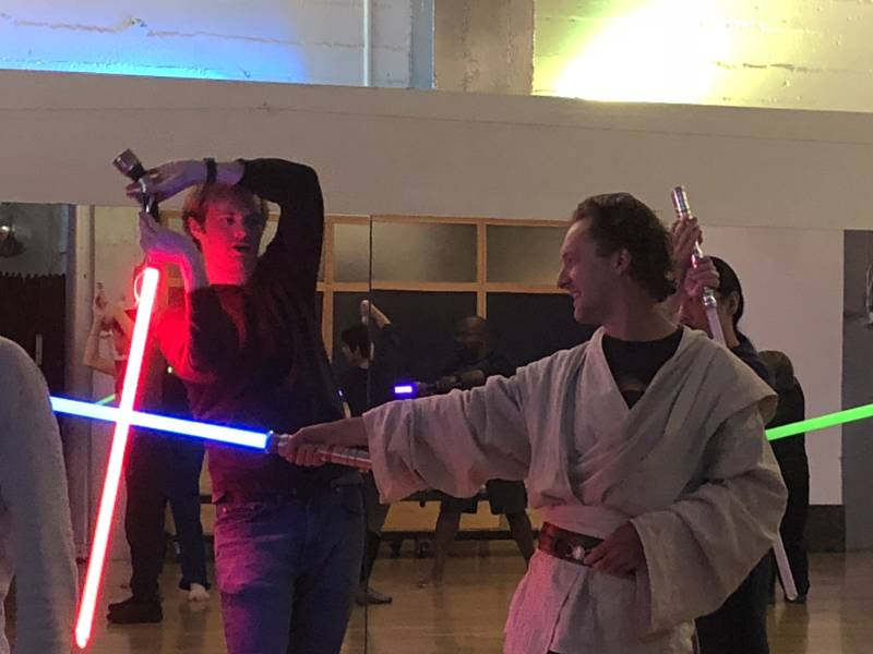 Golden Gate Knight instructors Steven Steffen and Lee Thomason demonstrate the next moves in the sequence the class is learning. Though costumes are not required for the class, many feel create their own.