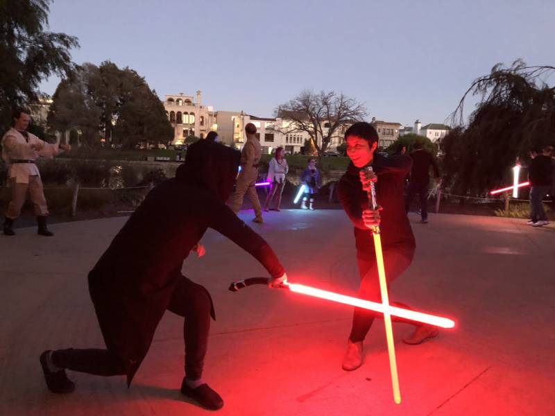 Jin di Giordano, Vallejo and Shawna Seth, San Francisco, practice a new technique at a Saber Guild event. Local lightsaber combat groups practice across the Bay Area and give Star Wars fans a unique workout experience.