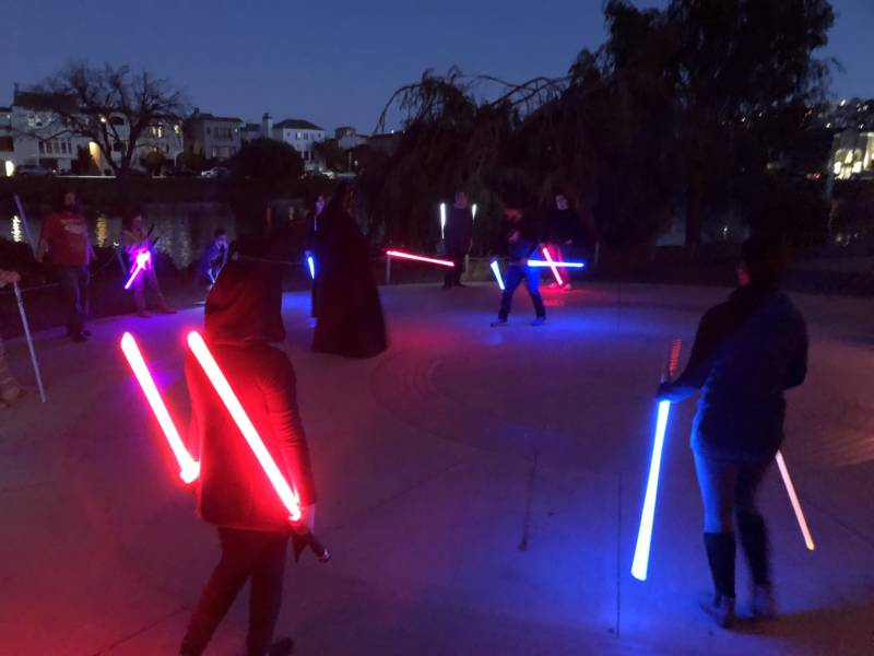 Lightsabers light up the night as students wrap up a Saber Guild class.