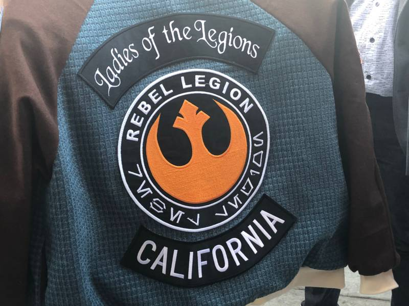 Members of the costume club Rebel Legion adorn their jackets with patches earned through involvement in the Star Wars fan community. Ladies of the Legions is one of many smaller unofficial communities within the larger costume groups.