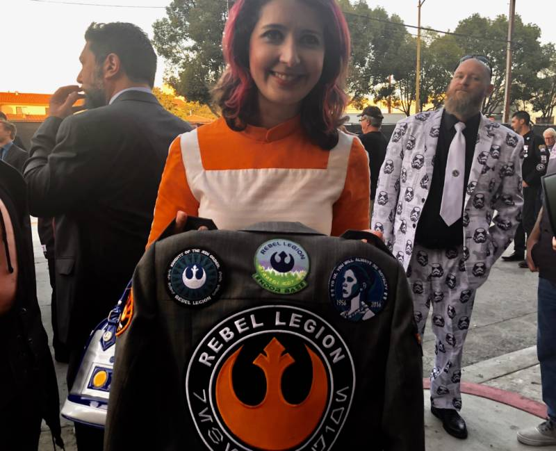 Pat Yulo shows off her patches, earned through participating in the Rebel Legion. She has created numerous screen-accurate costumes for herself, in addition to lending her skills to her fellow group members.