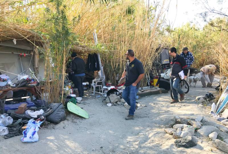 Homeless outreach workers visit a homeless camp in the Tujunga-Sunland area near Sylmar.