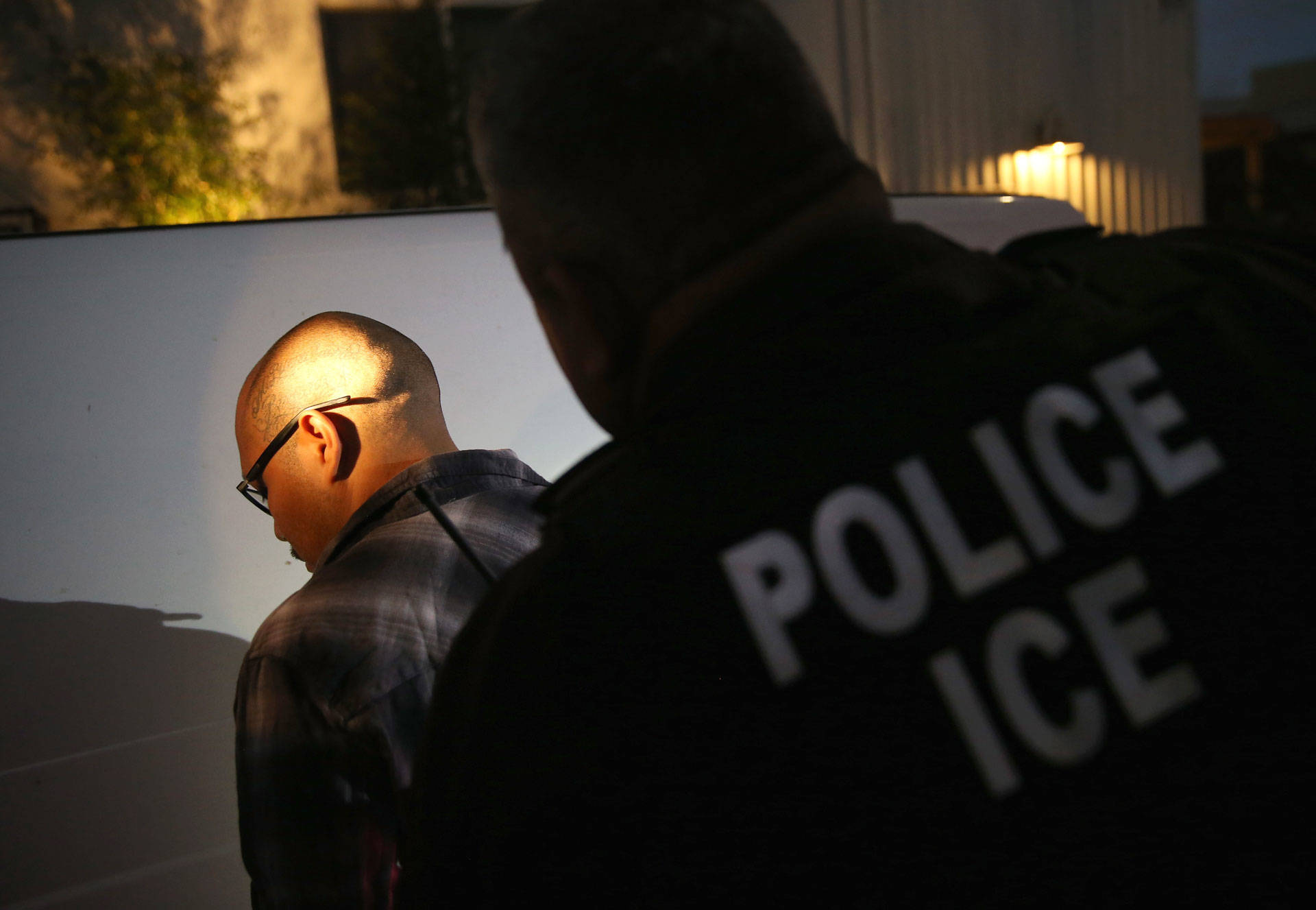 A man is detained by Immigration and Customs Enforcement (ICE) agents in October 2015 in Los Angeles John Moore/Getty Images
