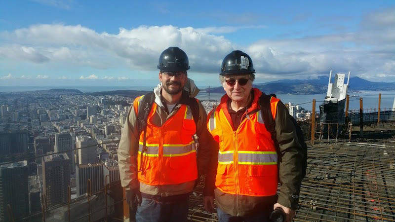 Jim Campbell (R) and Sean McGowen on the roof of Salesforce Tower before the crown was built.