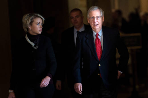 Senate Majority Leader Mitch McConnell (R-KY) walks to the floor of the Senate on Capitol Hill on December 1, 2017.