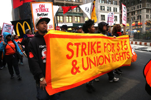 In this Nov. 10, 2017 photo, thousands of people took to the streets to stage protests in front of businesses that are paying some of their workers the minimum wage. In 2018 state minimum wage increases to $10.50 per hour for businesses with 25 or fewer employees and to $11 per hour for those with 26 or more employees.