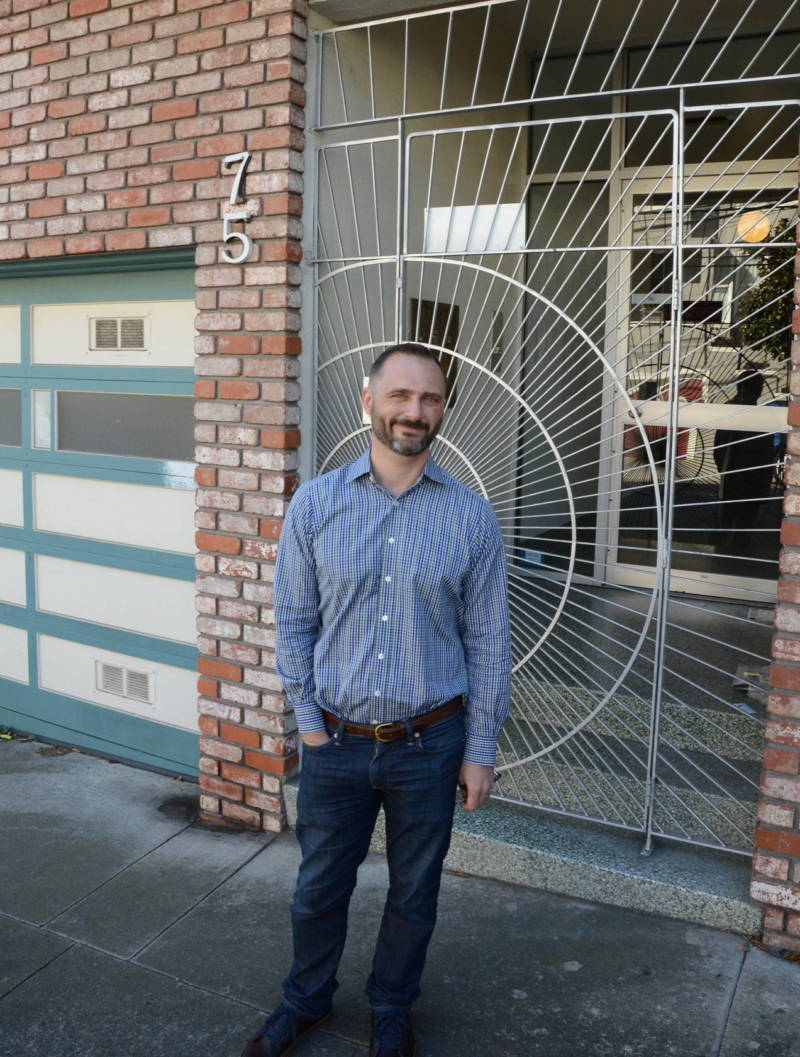 "LGBTQ historian Don Romesburg stands in front of the Castro apartment building he was priced out of in 2011. ""There was absolutely no way we could afford anywhere else remotely close to the Castro,"" Romesburg said."
