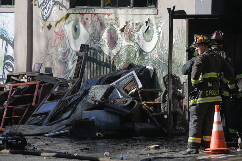 Firefighters work at the scene of the Ghost Ship warehouse fire on Dec. 3, 2016 in Oakland. The fire killed 36 people.