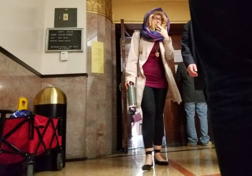 """Leah """"Swan"""" Vega leaves a preliminary hearing in Oakland on Dec. 7, 2017, where a jidge is weighing evidence against Derick Almena and Max Harris to determine whether they will stand trial for manslaughter following the Ghost Ship fire that killed 36 people."""