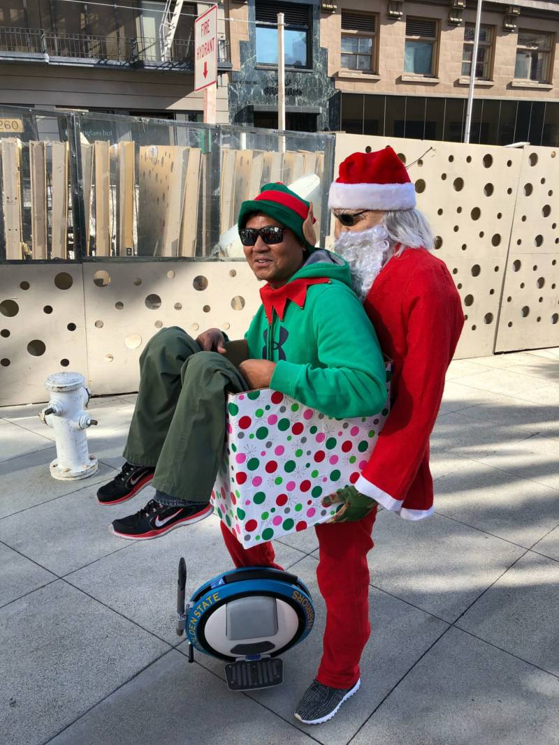 "Neil Macapagal at SantaCon 2017 at Union Square in San Francisco. He says it took ""a day or two"" to build his ride-along Santa."