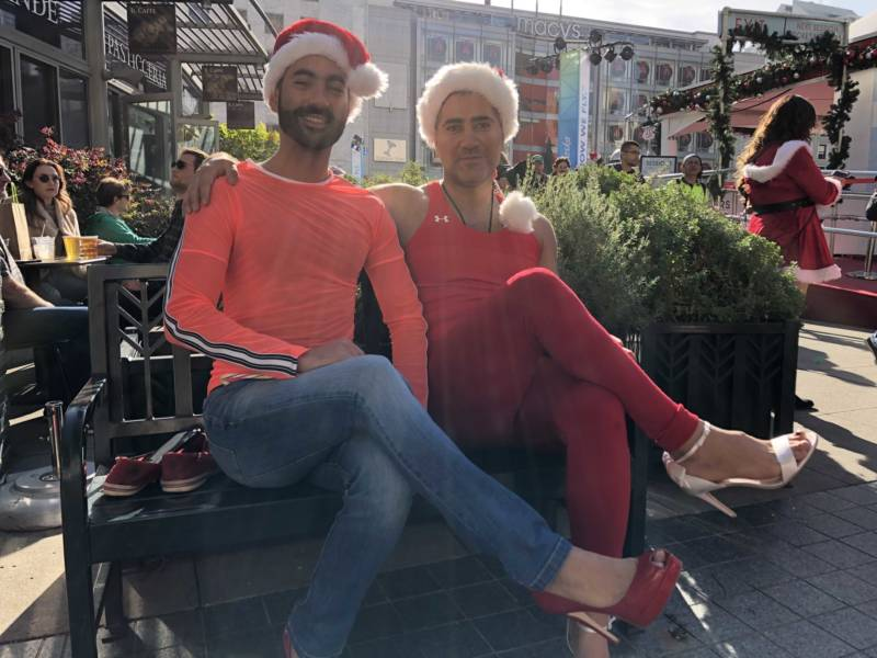 Sam and Francisco Presley just after changing into their high heels for SantaCon 2017 at San Francisco's Union Square. They said they wanted to come out to see the creativity because they didn't have Christmas in their home country of Iran.