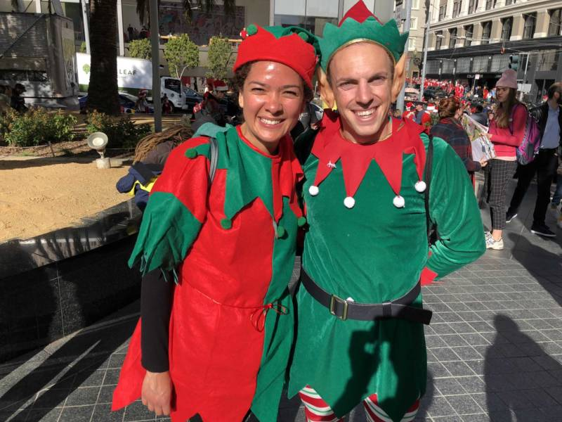 "Eve Sotomayor and Scott Merrick dress as elves at SantaCon 2017 in San Francisco's Union Square. Sotomayor and Merrick know each other from South Carolina and both recently moved to the city. Merrick said when they heard about SantaCon, they decided, ""We'll do that instead of going on a hike."""