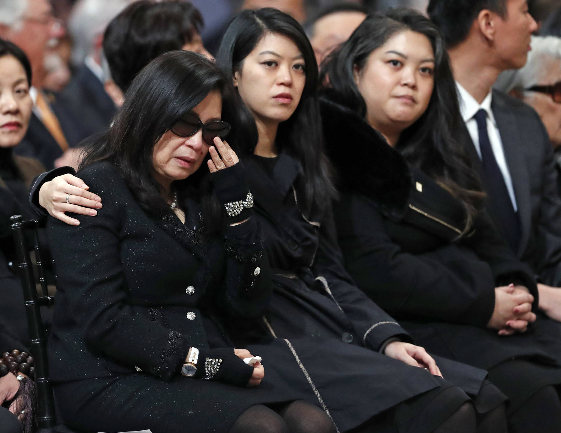 Anita Lee and her daughters, Brianna and Tania, during a service Celebrating the Life of Mayor Edwin M. Lee at San Francisco City Hall on Sunday, Dec. 17, 2017. Scott Strazzante/San Francisco Chronicle via AP, Pool