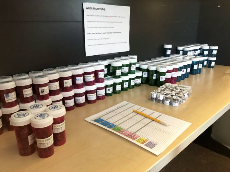 Vials of medical marijuana line a desk at the headquarters of a delivery service in south Orange County on Nov. 29, 2017.